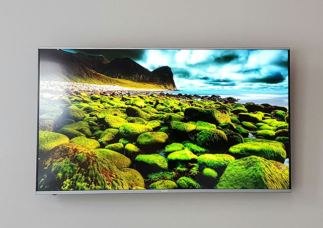 photo of a flat screen television mounted on a wall