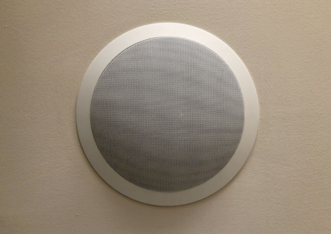 photo of a ceiling speaker, installed by Innovative Communication Integration for distributed audio and video service