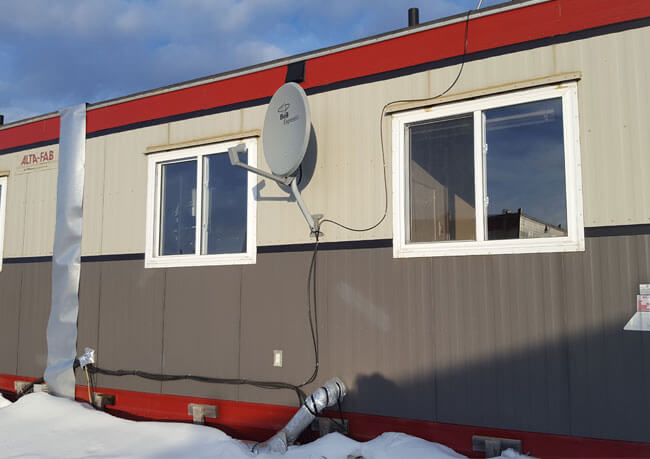 photo of a satellite installation at a remote work site in Alberta