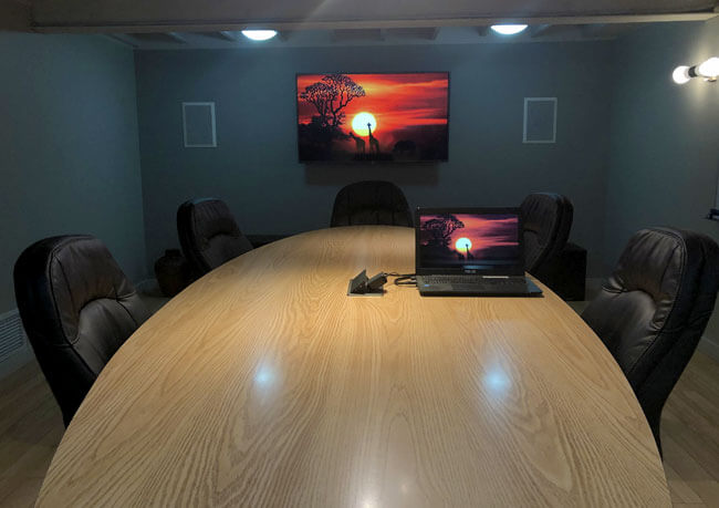 photo of a boardroom outfit with state-of-the-art technology for meetings and video calls