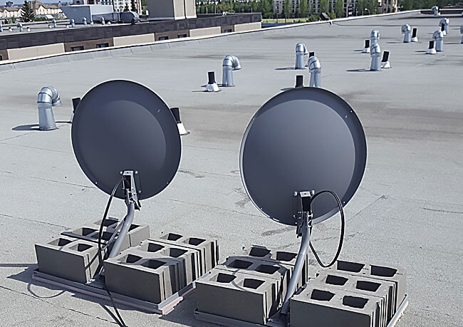 photo of satellites installed on a commercial building in Edmonton by the satellite technicians at Innovative Communication Integration