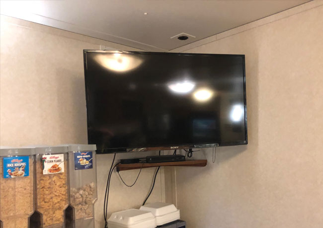 photo of a tv mounted and installed in an industrial work site in Alberta