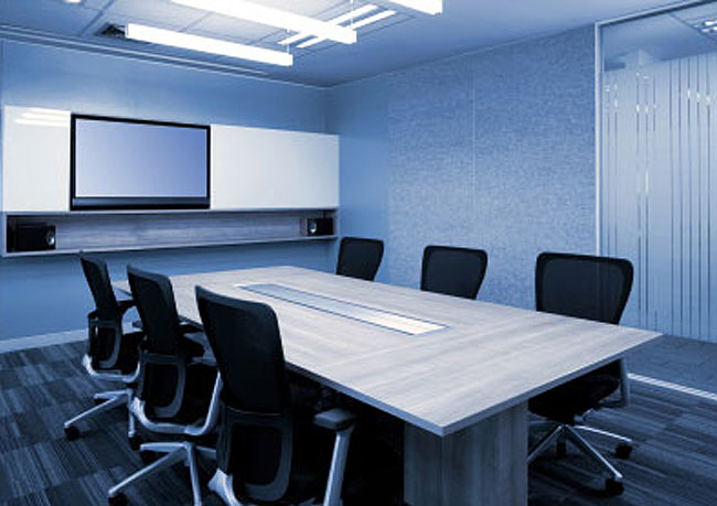 photo of a boardroom with audio and visual equipment, a hospitality service offered by Innovative
