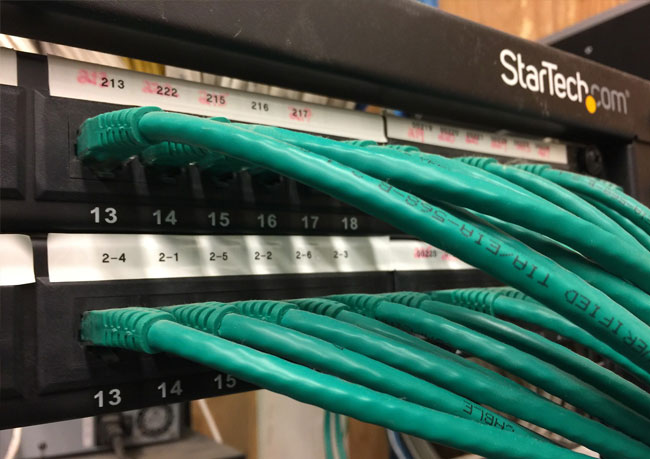 photo of a network switch, commonly used to enhance a workplace network